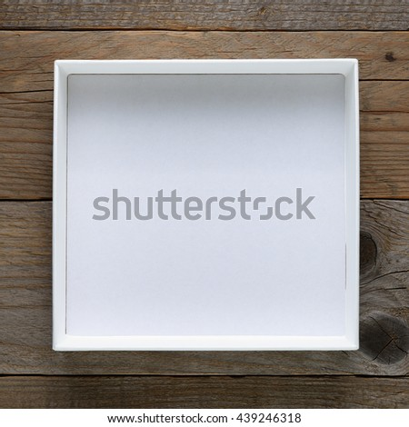 Empty open box on wooden table top view
