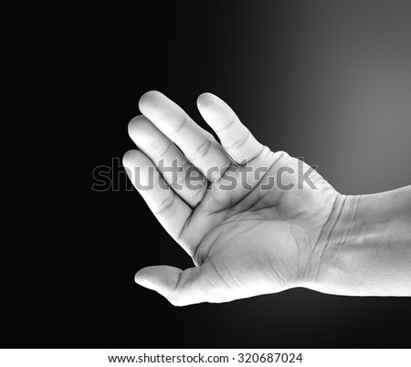 empty open hand of a man with black background