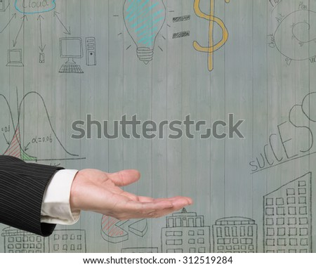 Empty open palm gesture of male hand with business concepts doodles on old green wooden wall background. - stock photo
