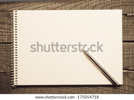 Empty or blank paper with pen on wooden backround  - stock photo