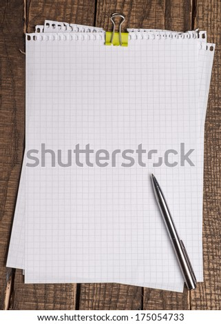 Empty or blank paper with pen on wooden backround