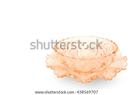 Empty orange crystal cup isolated on white