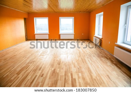 Empty orange room - stock photo