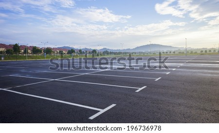 Empty outdoor parking space - stock photo