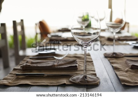 Empty outdoor restaurant table  - stock photo
