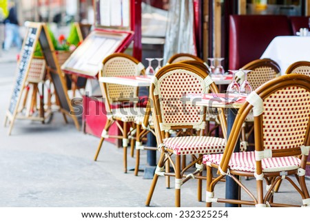Empty outdoor restaurant table in Paris, France. - stock photo