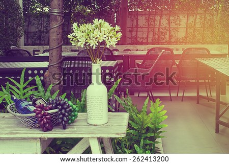 Empty outdoor restaurant table in vintage style. - stock photo