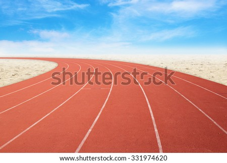 empty outdoor running track with desert and sky background