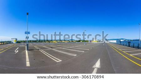 empty outdoors parking area under blue sky - stock photo