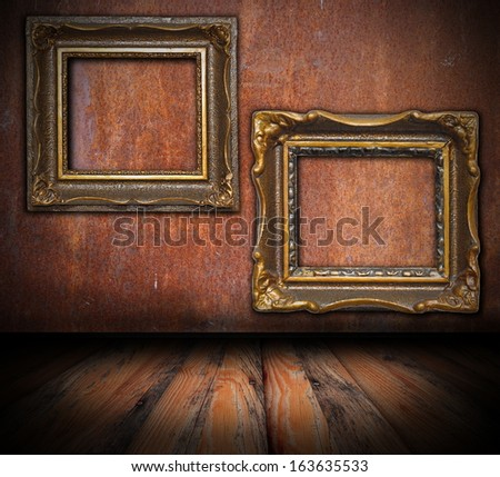 empty painting frames on rusted wall, interior architectural backdrop for your design