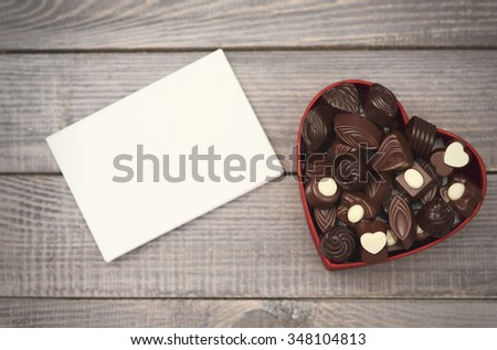 Empty paper and opened chocolate box
