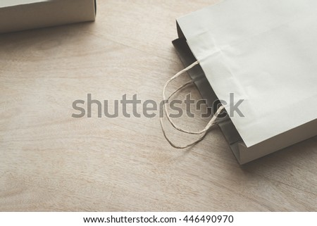 Empty Paper bag on a wooden under sunlight