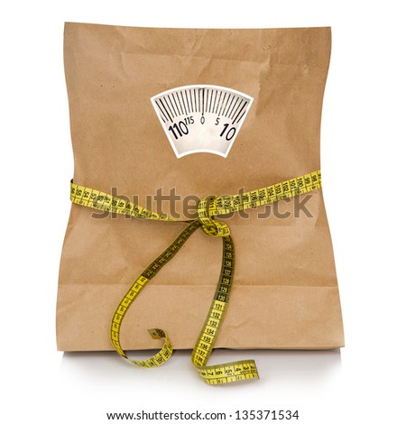 empty paper bag with a tape measuring - stock photo