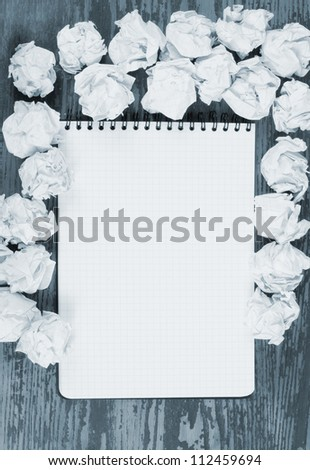 Empty paper, crumpled paper on wooden table - stock photo