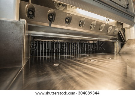 empty paper guillotine in a modern offset printing facility