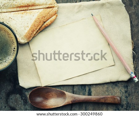 empty paper note  with coffee and bread wheat.
