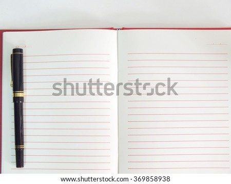empty paper notebook background with pen