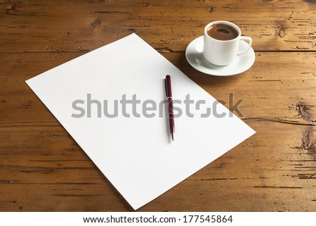empty paper on wood background with turkish coffee - stock photo
