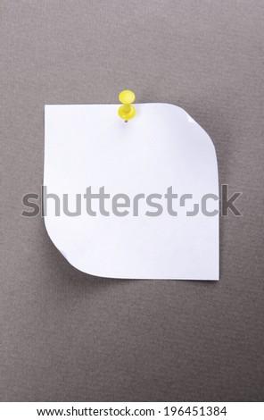 Empty paper sheet on grey background - stock photo