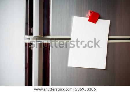 Empty Paper Sheet On Refrigerator Door Stock Photo