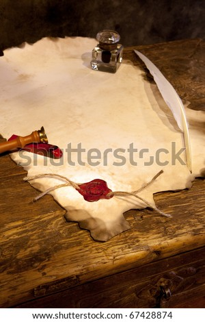 Empty parchment scroll with wax seal and feather quill - stock photo