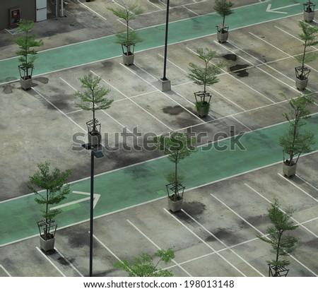 Empty parking garage  and garden - stock photo