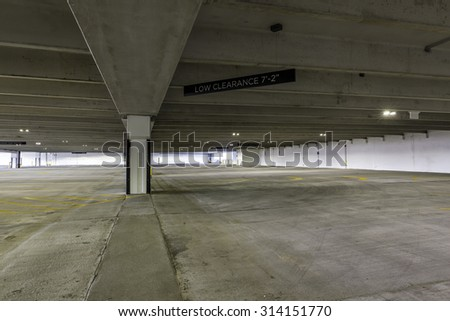 Empty parking garage with sign - stock photo