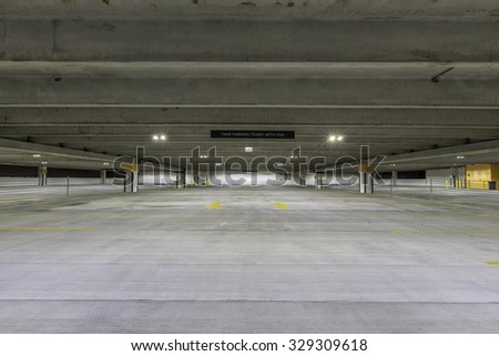 Empty parking garage with sign