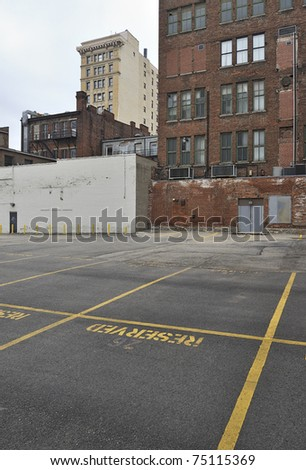 Empty parking lot and buildings in rundown downtown area, Cincinnati, USA - stock photo