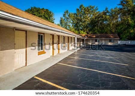 Empty parking lot near motel - stock photo