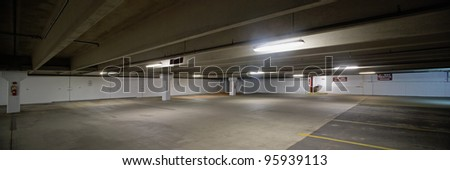 Empty parking lot underground garage panoramic scene - stock photo