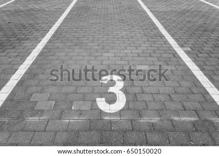 Empty parking spot with a number