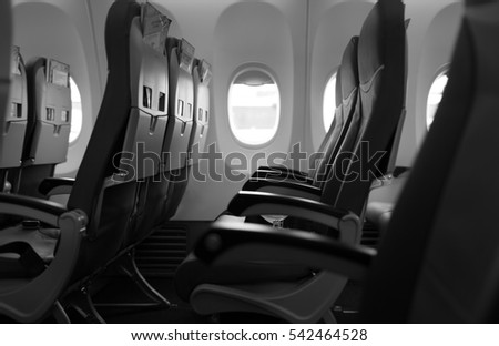 Empty passenger airplane seats in the economy class cabin