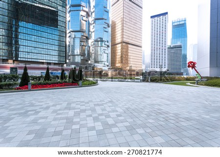 empty pavement and skyscrapers in modern city - stock photo