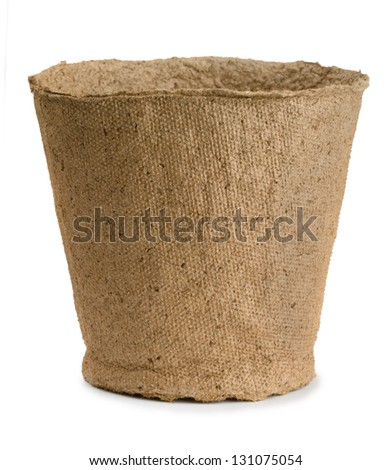 Empty peat pot isolated on white - stock photo