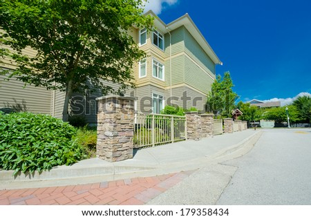 Empty pedestrian sidewalk with townhouse, condo at the back. - stock photo