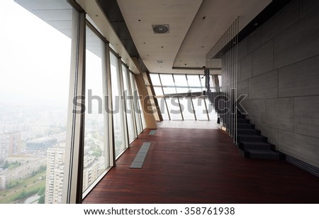 empty penthouse,  modern bright duplex office apartment interior  with staircase and big windows - stock photo