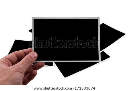empty photo frame held in the hand on white background - stock photo