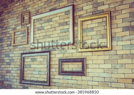 Empty photo frame on brick wall textures - Vintage Film Filter
