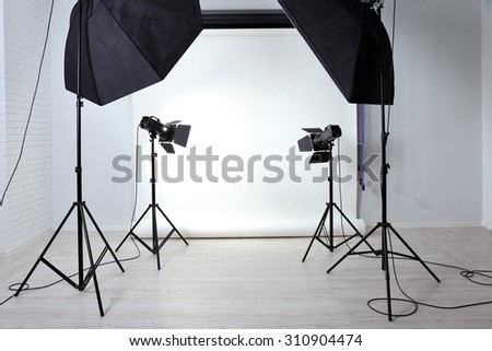 Empty photo studio with lighting equipment - stock photo