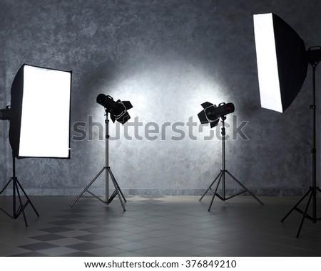 Empty photo studio with lighting equipment - stock photo