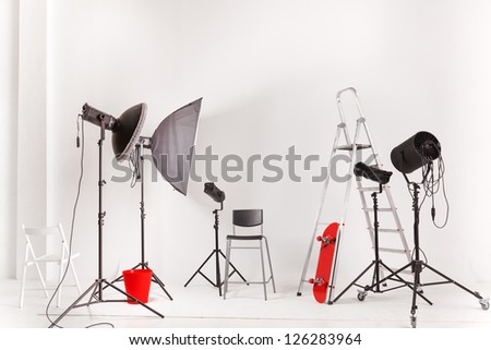 Empty photographic studio with modern lighting equipment - stock photo