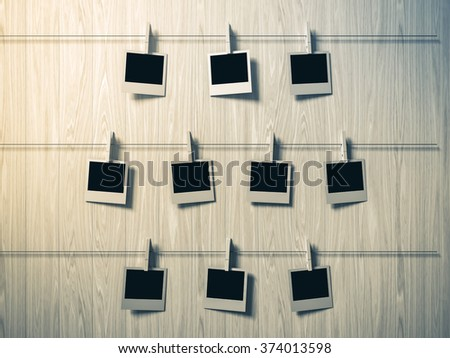 empty photos frames on wood background, concept art - stock photo