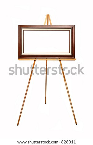 empty picture frame waiting for your art work on wooden easel