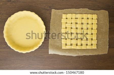 Empty pie crust and lattice pastry top - stock photo