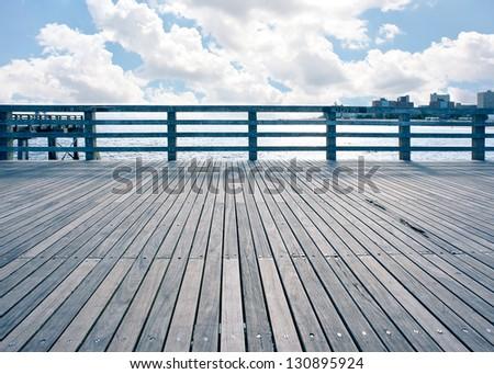Empty pier at Coney Island beach, New York City. - stock photo