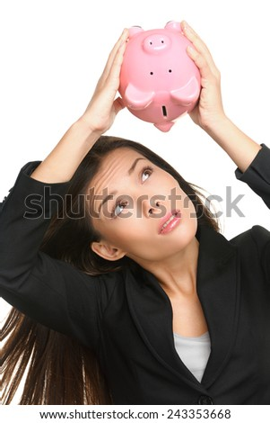 Empty piggy bank. Money debt, bankruptcy and lost savings concept. Business woman or banker showing empty pink piggy bank isolated on white background. - stock photo