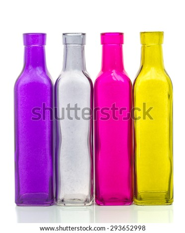 Empty pink yellow  violet and gray bottle isolated on white background - stock photo