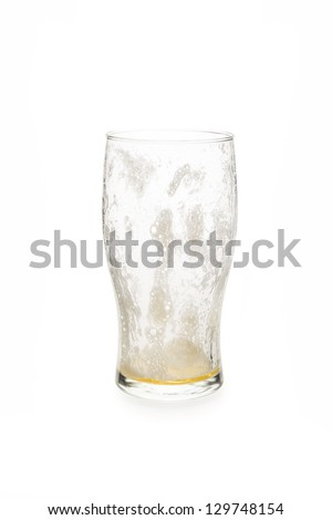 Empty pint glass with foam on the inside. - stock photo