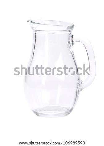 Empty pitcher for juice or milk on white background - stock photo
